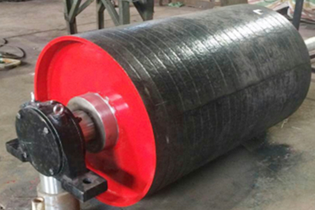 What is the main reason for the damage of the belt conveyor roller?